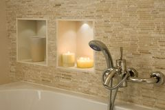 Shower head. And taps over a bath with candles stock photos
