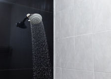 Shower head with water drops flowing Stock Image