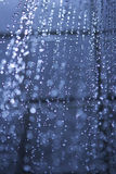 Shower jet. Running water from a shower head with water drops Stock Image