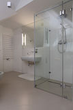 Shower in modern bathroom. Bright modern bathroom with glass shower Royalty Free Stock Photography