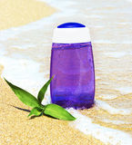 Shower product on sand Royalty Free Stock Images