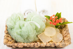 Shower puff and glycerin soaps in banana leaf basket. Close up Stock Images