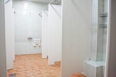Shower room. Fitness center shower room interior in fluorescent light stock image