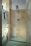 Shower room. A shower room with decorative glass and elegant tiles stock photo