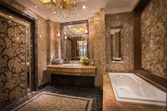 The shower room. The changing of family decoration to the hotel style, shown in the picture is a shower room of Chinese villa royalty free stock photo