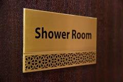 Shower room. Golden shower room sign on a door royalty free stock photo