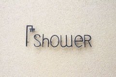 Shower sign. On sand wall Royalty Free Stock Images