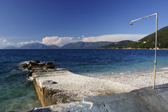 Shower at a small pier. Kefalonia, Greece Royalty Free Stock Images