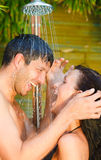 Shower spa couple. Lovely couple under shower outdoor Stock Image