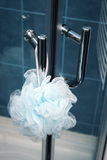 Shower sponge. A sponge hanging on the showers handle Royalty Free Stock Images