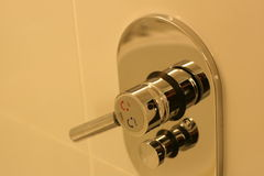 Shower tap. Turned towards hot Royalty Free Stock Images