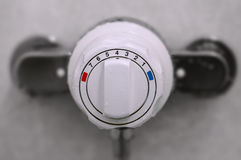 Shower thermostatic power and heat controller close up. Shower thermostatic power and heat controller Royalty Free Stock Photos