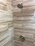 Shower tiles newly installed inside my bathroom royalty free stock photo