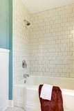 Shower tub white classic tile and blue wall. Stock Photo