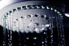 Shower water drops on black background Stock Images