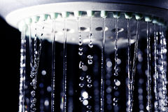 Shower water drops on black background Royalty Free Stock Image