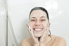 Shower woman. Happy smiling woman washing shoulder Stock Photo