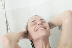 Shower woman. Happy smiling woman washing shoulder Royalty Free Stock Photography