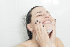 Shower woman. Happy smiling woman washing shoulder Royalty Free Stock Photo