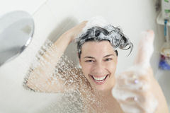 Shower woman. A positive thumb up woman with big smile on shower Stock Images