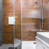 Shower with wooden effect tiles Stock Image