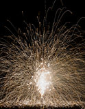 Showering sparks light show from ground fireworks fountain Royalty Free Stock Photos