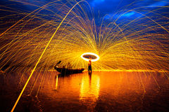 Showers of hot glowing sparks. From spinning steel wool Royalty Free Stock Photography