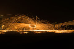 Showers of hot glowing sparks from spinning steel wool. Showers of hot glowing sparks from spinning steel wool yellow Royalty Free Stock Image