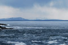 Showers over Yellowstone Lake. Somber appearance on ice-packed Yellowstone Lake Stock Images