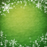 Showflakes over green cloth Royalty Free Stock Photo