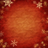 Showflakes over red cloth Royalty Free Stock Photo