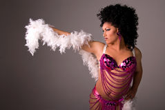 Showgirl. Glamorous Drag queen wearing a pink beaded showgirl costume, with a feather boa draped over her arm stock photos