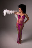 Showgirl in pink costume. Royalty Free Stock Photography