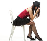 Showgirl woman dance in red corset chair isolated Royalty Free Stock Photography