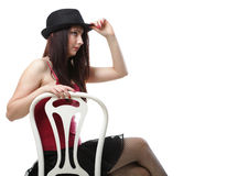 Showgirl woman dance in red corset chair isolated Stock Images