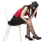 Showgirl woman dance in red corset chair isolated Stock Photo