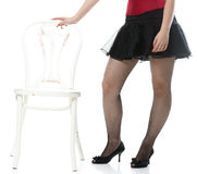 Showgirl woman dance in red corset chair white isolated Stock Photos
