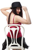 Showgirl woman dance in red corset chair white isolated Royalty Free Stock Photos