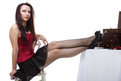 Showgirl woman dance in red corset chair white isolated Stock Photography