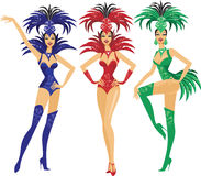 Showgirls. Beautiful showgirls in colorful plume costumes dancing Stock Photos