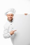 Showing. Attractive cook shows on a white background royalty free stock images