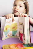 Showing. Young girl talking about her drawing stock illustration