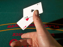 Showing The Aces. A poker player tosses his winning hand on the table royalty free stock images