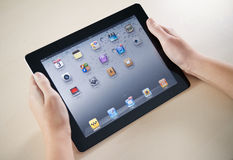 Showing Apple iPad2 Homepage. Woman hands holding Apple iPad2 with homepage on a screen Stock Photography