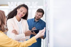 Showing approval for her colleague's brillant project brief Royalty Free Stock Image