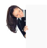 Showing blank. Happy smiling beautiful young business woman showing blank signboard, isolated over white background Royalty Free Stock Images