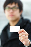 Showing blank business card Stock Photo
