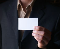 Showing a blank card. Businessman with blank card Stock Photo