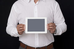 Showing a blank digital tablet Royalty Free Stock Images