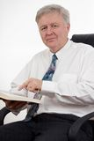 Showing in the Book. Man sitting in an armchair and showing something in the Bible stock photo